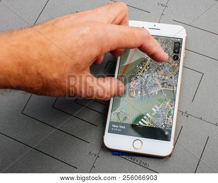 Paris, France - Sep 26, 2016: New Apple Maps Navigation On Iphone With Apple Maps Over New York Flyo