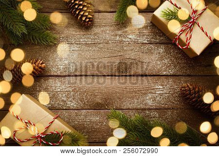 Christmas Border With Vintage Gifts And Decoration On Old Wooden Background.