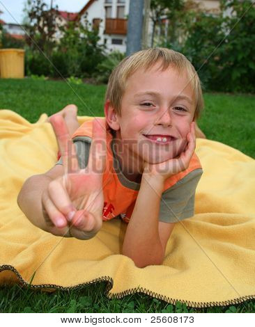 victory boy on blanket in garden