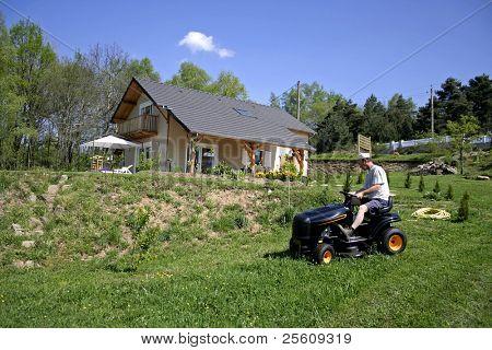 man cutting cutting his lawn