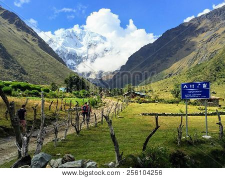 Walking Through An Open Valley Along The Salkantay Trail On The Way To Macchu Picchu, Peru