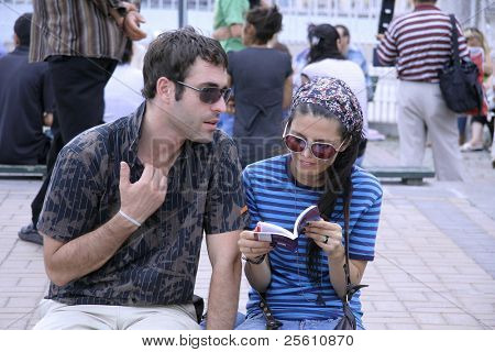 couple from different cultures trying to communicate poster