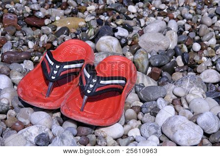 red heart shoes on pebble beach
