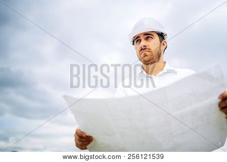 Portrait Of Young, Handsome Civil Construction Engineer Working On Construction Site