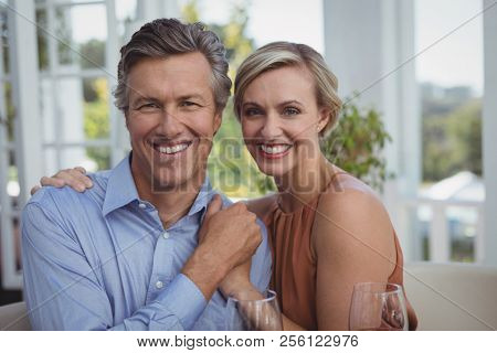 Portrait of smiling couple enjoying together in restaurant
