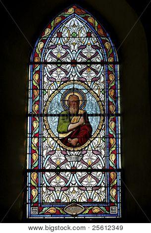 Stain glass window in little church in Correze in France