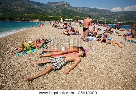 ZAGREB - JULY 29: Crowded beach of Zlatni Rat on June 05, 2009 in Bol, Croatia. Bol is one of the busiest tourist destinations on the adriatic islands.
