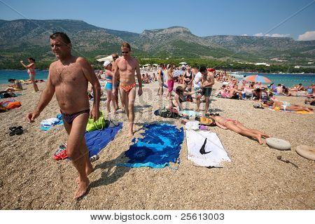 ZAGREB - JULY 29: Crowded beach of Zlatni Rat on June 05, 2009 in Bol, Croatia. Bol is one of the busiest tourist desinations on the adriatic islands.