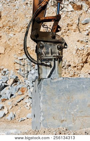 Close-up of a large jackhammer in a marble quarry (Carrara white marble) in the Apuan Alps (Alpi Apuane). Tuscany, (Toscana), Italy, Europe poster
