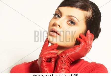 Atractive Brunet In Red Blouse And Red Gloves