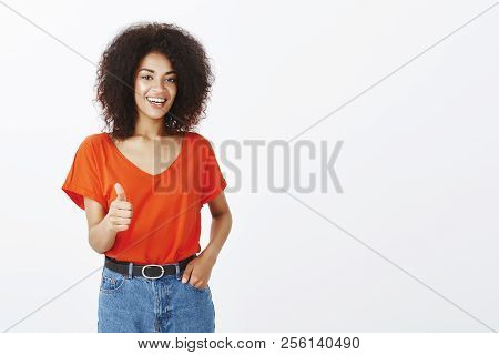 Good Job, Girl. Confident Pleased Attractive Woman With Afro Hairstyle, Holding Hand In Pocket And S