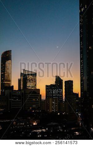 Abu Dhabi, UAE - February 08, 2017: View of Abu Dhabi city beautiful towers at sunset - WTC, The Mal
