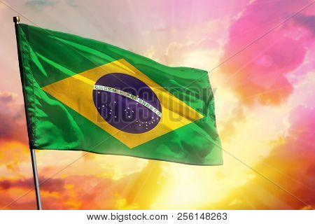 Fluttering Brazil Flag On Beautiful Colorful Sunset Or Sunrise Background. Brazil Success And Happin