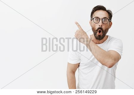 Fantastic, Look. Portrait Of Amazed And Impressed Handsome Adult Man With Beard And Wrinkles In Glas