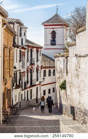 Granada, Spain - February 22, 2015: Urban Scene, View Of A Street In Granada, Andalusia, Southern Sp