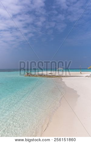 Amazing Blue Water In A Desert Island In A Blue Sky Day With A Wood Hut