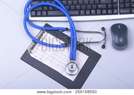 Stethoscope On A Modern Keyboard, Rx Prescription On White Table With Space For Text