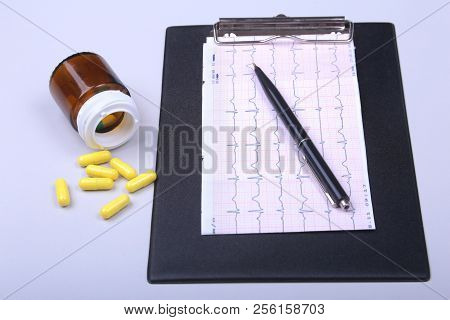 Stethoscope, Rx Prescription And Assorted Pills On White Table With Space For Text.