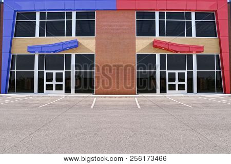 Unoccupied Generic Store Front, Business Or Professional Office Space. Sunny Summer Day.