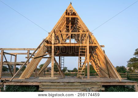Wood Frame Residential Building Under Construction. New Residential Construction Home Framing Agains