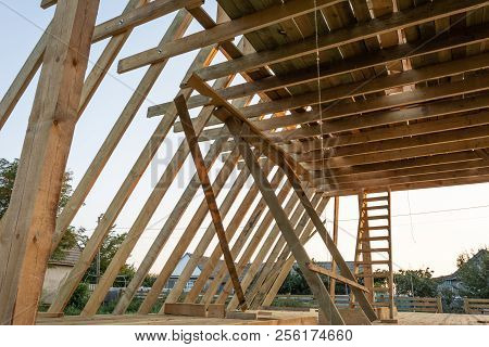 The Beginning Of The Construction Of The Triangular Cottage. House Frame Building.
