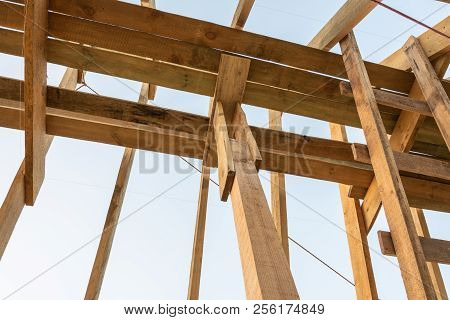 Roof Frame Structure In Wood Frame Home Under Construction At Sunset, Shagany Lagoon, Ukraine.