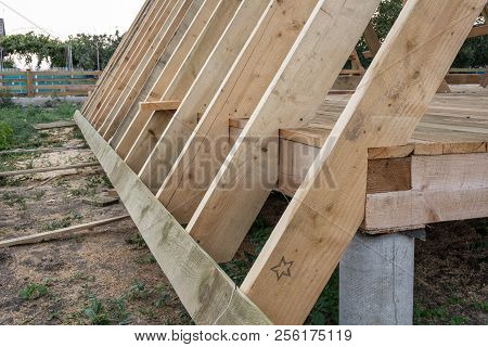 Fastening Of Rafters To The Floor. Construction Of Frame House Parts.