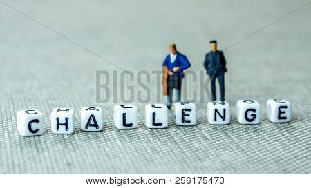 White Cubes With Word Challenge On Grey Background With Miniature Figurines