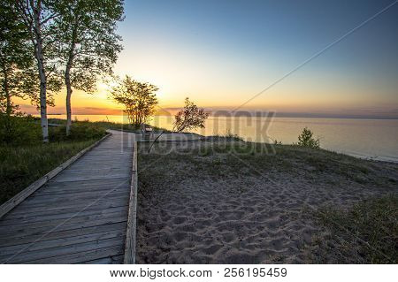 Michigan Boardwalk Scenic Sunset. Sunset On The Coast Of Lake Superior In The Hiawatha National Fore