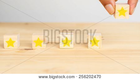 Business Successful Concept, Hand Man Try To Put The The Fifth Star To Complete Five Star Rating To