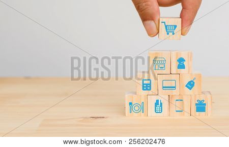 Smart Retail Concept, Hand Man Try To Put The Icon Of Retail Connect ,including Shopping Cart, Custo