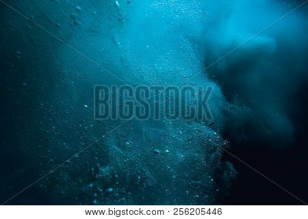Wave Underwater With Air Bubbles. Blue Sea In Underwater