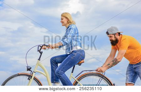 Support Helps Believe In Yourself. Support And Friendship. Woman Rides Bicycle Sky Background. Man H