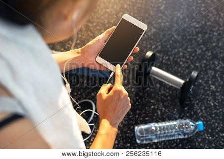 Young Sport Woman In Gym Using Smartphone, Fitness ,training Lifestyle Concept