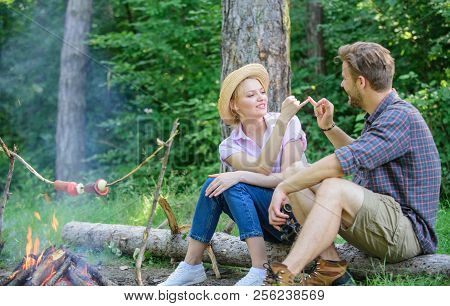 Couple Tourists Hold Gesture While Sit Log Bonfire. Man And Girl Play Hand Game. Couple Play Hand Ga