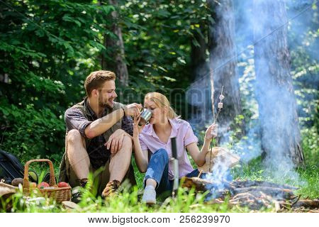 Weekend Picnic. Food For Hike And Camping. Couple Sit Near Bonfire Eat Snacks And Drink. Couple In L