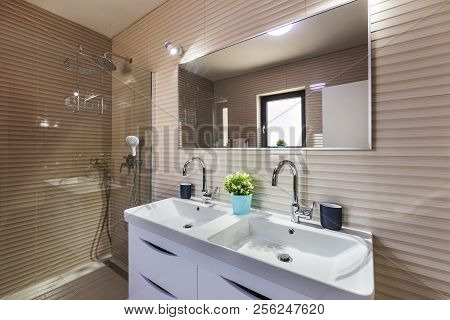 Illuminated Interior Of Modern Bathroom And Shower