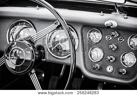 Steering Wheel And Dashboard In Historic Vintage Red Car. Retro Automobile Interior Scene. Old Vehic