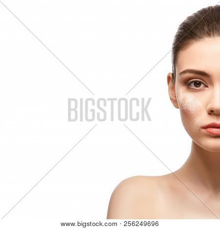 Beautiful Girl Applying Powder On Face Isolated On White