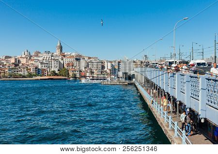 Istanbul, Turkey - August 14, 2018: Men Catch Fish From The Galata Bridge On August 14, 2018 In Ista