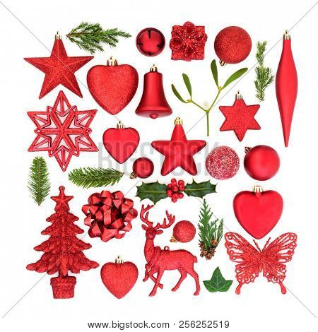 Christmas red bauble tree decorations and ornaments with winter flora on white background. Festive Christmas card for the holiday season.