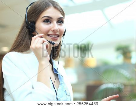 Woman Customer Support Operator With Headset And Smiling.