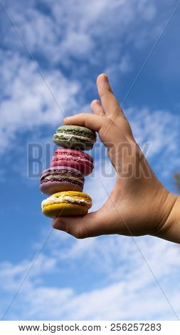 Colorfull Macaroon On Blue Clouds Sky Backround