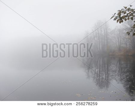 Thick Dense Fog, Haze On The River During The Late Autumn. Misty, Cloudy Defocused Lake. Landscape W