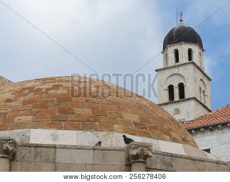 Dubrovnik, Croatia - August 3 2018: Dome Roof Of Water Well And Church Tower