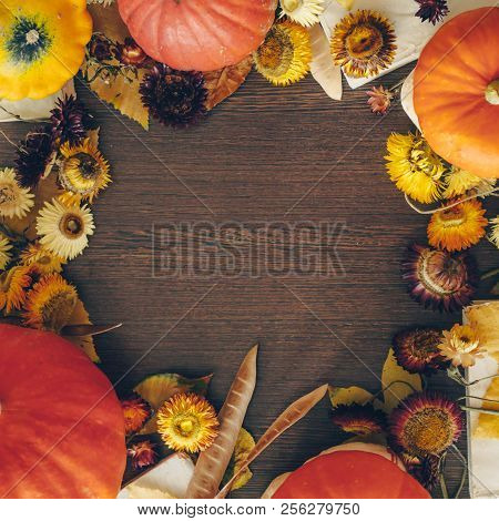 Thanksgiving Background With Autumn Dried Flowers, Pumpkins And Fall Leaves On The Old Wooden Backgr