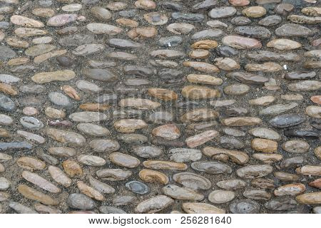Old Cobblestone Street. Beautiful Medieval Stone Background.