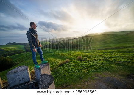 Successful Man Looking Up To Sunset Sky Celebrating Enjoying Freedom. Success, Peace Of Mind Concept