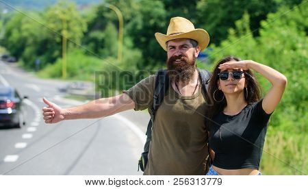 Travellers Try To Stop Car. Couple Hitchhikers Travelling Summer Sunny Day. Couple Travelers Man And