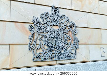 Berlin, Germany - August 18, 2018: Dieu Et Mon Droit, Royal Coat Of Arms Of The United Kingdom.